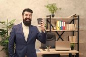 Cup Of Coffee May Actually Help To Contribute To Overall Happiness. Bearded Manager Hold Cup Coffee. poster