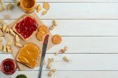 Fantastic Jam And Peanut Butter Sandwich, Jars, Knife, Top-view. Light Wooden Background, Place To I poster