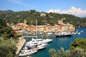 Aerial view on town of Portofino and small harbor with yachts and boats on Ligurian sea, Italy.