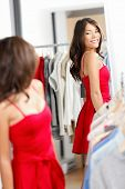 Woman Shopping Looking In Mirror Trying Clothes Dress