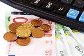 Calculator, Coins And A Hundred Euro Bill