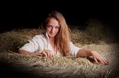Girl With Blond Hair Is In The Hayloft