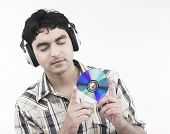 Asian Male Of Indian Origin Listening To Music