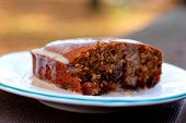 stock photo of toffee  - a specialty sticky toffee pudding made with dates and brown sugar - JPG