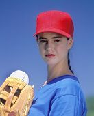 Young Woman Baseball Player Ready To Pitch