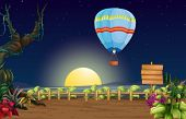 Illustration of a hot air balloon in a bright full moon