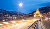 TROMSO, NORWAY - DECEMBER 30: Arctic Cathedral shines at dusk on December 30, 2012. This Church is