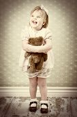 Vintage baby with bear