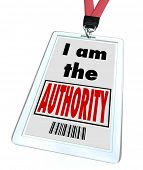 A badge and lanyard with printed pass with the words I am the Authority to illustrate that you are the top expert in your field or you are a high ranking official or leader of your group