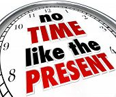 image of punctuality  - A clock with the words No Time Like the Present telling you to get things done now and not put them off or procrastinate - JPG