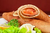 Pancakes with salted red salmon fish