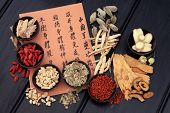 Traditional chinese herbal medicine selection with mandarin calligraphy. Translation describes the m
