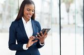 cheerful african businesswoman using tablet computer