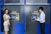 image of button down shirt  - Two people standing and withdrawing money from ATM - JPG