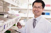 Pharmacist examining prescription medication in a pharmacy