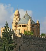 The Catholic Church of Dormition in Jerusalem. The morning sun illuminates the dome and the tower of