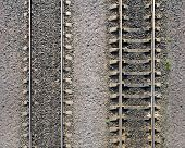 Detailed Industrial Background Texture Of Railway Tracks On Gravel