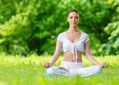 Woman sits in lotus position zen gesturing. Concept of healthy lifestyle and relaxation