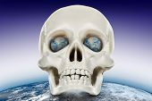 The Human Skull On A Background Of The Planet Earth.