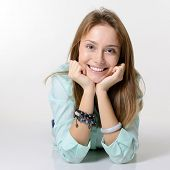 Portrait of attractive girl lying down and happy smiling looking at camera