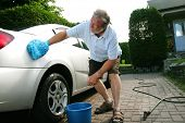 stock photo of friction  - Man washing the silver car - JPG