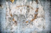 Abstract Grunge Background With Torn Paper On Wall