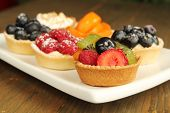 Plate with a nice assortment of fresh fruity tart