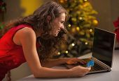 Happy Young Housewife With Credit Card Making Online Christmas P