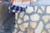 Worker wall cladding stone