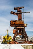 Old Crane On Seaport. Petropavlovsk-kamchatsky City, Kamchatka, Russia