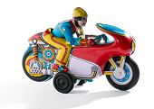 picture of tin man  - Biker retro tin toy with a biker in goggles crouched down on a colorful motorcycle mounted on wheels on a white background - JPG
