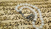 pic of tasbih  - islamic rosary beads over quran writings paternoster - JPG