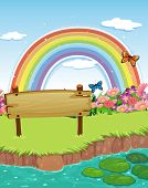 Illustration of an empty wooden signboard at the riverbank and a rainbow in the sky