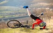 stock photo of exercise bike  - Mountain Biker has a painful looking crash with his bike - JPG