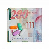 foto of shekel  - Pills and Shekel notes isolated on white - JPG