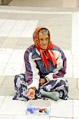 A beggar woman begging on a pedestrian street in Prilep, Macedonia.