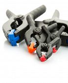 Plastic clamps on white background