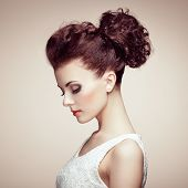 Portrait Of Beautiful Sensual Woman With Elegant Hairstyle.  Perfect Makeup