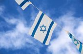 stock photo of israeli flag  - Israeli flags showing the Star of David hanging proudly for Israel - JPG