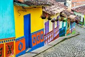 image of cobblestone  - Brightly colored street in town of Guatape in Antioquia Colombia - JPG