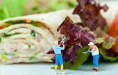 Tiny People Cutting Salad
