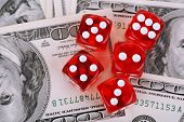 Red dices on dollars background