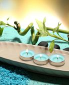 Beautiful spa setting with bamboo on wooden table, on bright background
