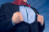 image of open shirt breast showing  - Businessman opens suit showing his shirt on background of sky face is not visible - JPG