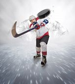 picture of hockey arena  - Ice Hockey player gives powerful pass moment - JPG