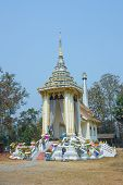 foto of crematory  - Thai style crematory with wreaths on blue sky background - JPG