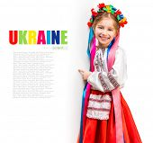 pic of national costume  - little girl in the Ukrainian national costume stand behind white board with space for text - JPG