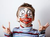little cute boy with facepaint like clown, pantomimic expressions close up