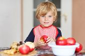 Adorable Little Child Helping And Baking Apple Pie In Home''s Kitchen