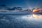 picture of tide  - sunrise over North sea coast at low tide Schiermonnikoog Netherlands - JPG